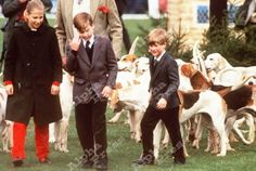 puppyprinceharry:    englandsprincess:    This is new for me! *-*    Color photo of the princes with the foxhounds. Can anyoneidentifythe girl with them?    That's Lady Gabriella Windsor.