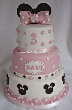 This Minnie mouse cake with bow on top in the colors pink, black and white I…