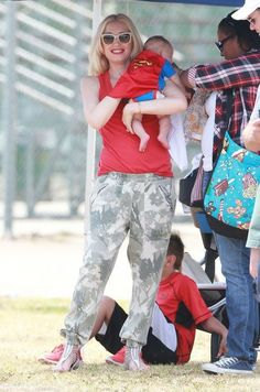 Gwen Stefani and Gavin Rossdale watch their son Zuma play football with their other boys Kingston and Apollo