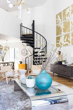 I love the addition of the spiral staircase in today's Before & After...