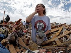 Carol Kawaykla searches for items in her destroyed home on May 23 in Moore, Okla.   5/20/2013 an EF5 tornado hit Moore, Oklahoma resulting in 24 deaths and 377 injuries.