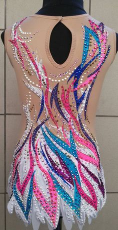 Beautiful designer rhythmic gymnastics leotard handmade,new . Design drawing on fabric acrylic paints. You can order any size or get this allready leotard size 122-126 cm age 7-8 with discount 10%. The leotard for the rhythmic gymnastics competition made with over 3500 rhinestones very high quality. You can choose another size and color. If you have any quastions, please ask.