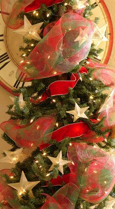 Notice that there are not a lot of ornaments.....just generous use of ribbon and fabric!  Hallway tree by KailleAsInKyle, via Flickr