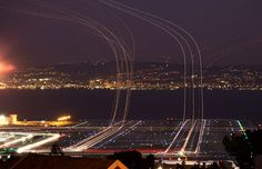 Long exposure shot of an airport of planes arriving and taking off