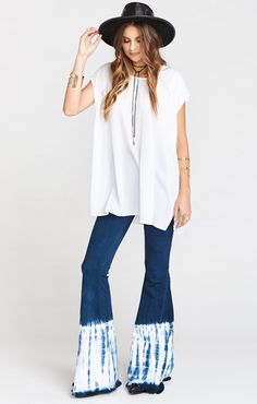 The highest ranked pull on super flares are here and ready to set you ahead of the curve.  Suck you in in all the right places with the perfect amount of stretch so you always feel free.   FINALLY you have a pair of high waisted jeans to wear your collection of Mumu crop tops with, as well as everything else in your closet.    Update!  Pant leg hem is now frayed!  Cut them yourself to any length you please!  These bells run true to size.  *MADE IN THE GORGE USA* *No pockets in front, 2…