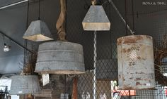 Old buckets turned hanging lamps