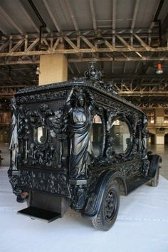 Exquisite old hearse. Someday when I die I want one like this to parade through town. I should make a note of that on my life insurance paperwork.