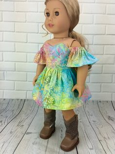 18 inch doll dress made to fit american girl. This Spring dress features a sweetheart bodice with drop ruffle sleeves creating the popular cold shoulder style. This pretty dress is the perfect short length for having fun. Bodice is fully lined and closes in the back with snaps. A perfect dress for spring or summer outings!  Dress is an original Hosch Posch pattern design.  Find other dresses here: https://www.hoschposchcreations.etsy.com  My doll and her shoes are not included. Plea...