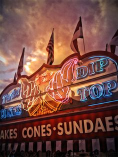 ice cream at the carnival (photo by Michael Brown) Fair Rides, Michael Brown, Beach Boardwalk, Rainbow Swirl, County Fair, Cool Photos, Amazing Photos, American Horror Story, Neon