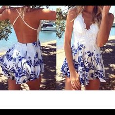 White and blue romper White and blue floral pattern shorts with a knitted top . V-neck body con romper . Brand new with tags never been worn None Other