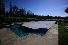 Nautilus Pools of Victoria BC built this stunning overflow and vanishing edge pool. The cover? Our HydraLux, mounted in-floor of course
