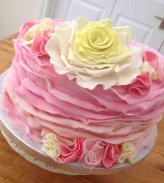 Girlie Pink Ombre cake with ruffle fondant frills in pink and peach with yellow gumpaste rose www.facebook.com/cakeheaven
