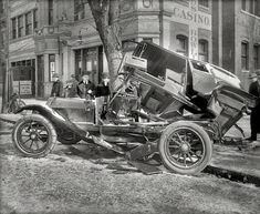 "February 4, 1916. Washington, D.C. ""Auto wreck at 14th & T,"" under a light dusting of snow and mold."