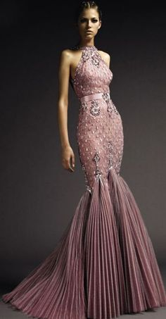 Versace.  Mauve gown.  Pleated mermaid skirt.  Halter.  All over beading in silver.  Stunning!