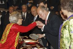 """MADRID.- Spanish King Juan Carlos (2R) awards the 2013 Cervantes Literature Prize to Mexican journalist Elena Poniatowska (L) as Spanish Queen Sofia (R) looks on at Alcala University in Madrid on April 23, 2014. The Cervantes Prize is considered the most prestigious literary award for the Spanish language literature and was attributed to Poniatowska in November 2013 for her """"literary career... AFP PHOTO / POOL / J.J.GUILLEN  More Information: http://artdaily.com/[/url] Copyright ©…"""