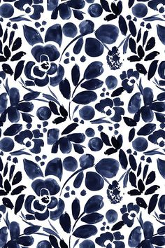 Beautiful hand painted watercolor floral pattern in navy on fabric, wallpaper, and gift wrap.