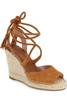 Tightly plaited wraparound laces tipped with tonal tassels add to the light, breezy aesthetic of these wedge espadrilles from Joie. Pair with a dress for the ultimate summer look!