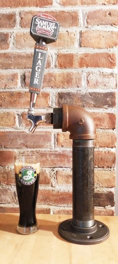 Unique Industrial Beer Tower Tap. There is a lot of potential for a really unique wall mounted beer tap being designed with piping of sorts.