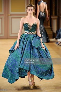 A model walks the runway during the Tony Yaacoub show as part of Paris Fashion Week Haute-Couture Fall/Winter 2013-2014 at Hotel Westin on July 2, 2013 in Paris, France.
