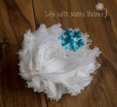 Winter Shabby Rose Hair Clip with Snowflake  This Winter Hair Clip features a White Shabby Rose with a Turquoise Satin Snowflake on a