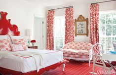 Red Patterned Curtains and Upholstered Red Bed in a Bedroom