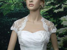 Ivory cap sleeve alencon lace bolero jacket bridal bolero bridal jacket bridal shrug wedding bolero wedding jacket wedding shrug. $69.99, via Etsy.