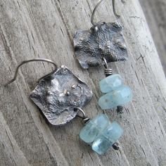 Beautiful pale blue genuine Aquamarine faceted nuggets are the star of these earrings. They are suspended from sterling silver squares that have been