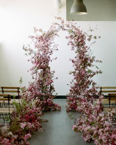 Another way to get that lush flower wall effect in a new way? Have your floral designer create a wild garden feel with aisle-lining blooms that connect to an equally organic feeling arch. The whole thing should feel like it just occurred naturally, e Wedding Aisles, Wedding Altars, Arch Wedding, Indoor Wedding Arches, Wedding Scene, Garden Wedding, Wedding Venues, Arc Floral, Floral Arch