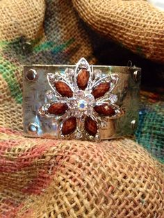 Leather cuff with silver hammered and soldered plate with brown brooch on Etsy, $65.00