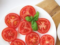 Sliced Tomato with sea salt, minced garlic, and drizzle with olive oil.