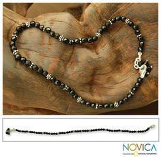 Evoking midnight darkness with black onyx, Narayani designs an elegant ankle bracelet. The handcrafted anklet clusters faceted gemstones in a circlet with sterling silver beads.