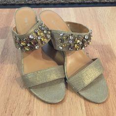 """Nine west size 8.5 Gold gem sandal. Almost new. Nine west size 8.5 gem sandal. Almost new. Shiny Gold. No damage 4""""wedge. Nine West Shoes Wedges"""
