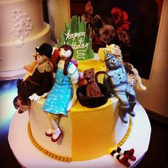 Follow the yellow brick road....to a fun birthday party. Wizard of Oz themed birthday cake. Photo by Sugar Flower Cake Shop. www.sugarflowercakeshop.com
