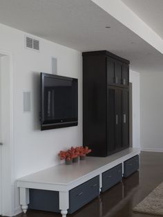 Nice storage ideas for basement or hallway.  Like TV with no cords showing.  Traditional Basement Design, Pictures, Remodel, Decor and Ideas - page 8