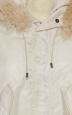 This **Giamba** parka is rendered in nylon and features rushed sleeves and a contrast fur hood.