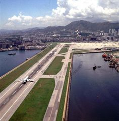 1990 The single runway at Kai Tak International Airport, seen from the east Kai Tak Airport, All Over The World, Around The Worlds, British Hong Kong, Civil Aviation, Aeroplanes, International Airport, Gliders, Seas