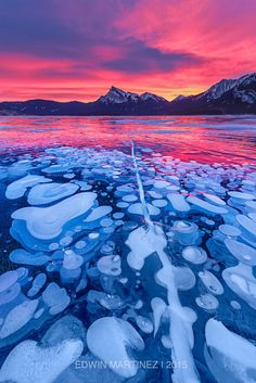 Unique Ice formations and fiery sky ~ Abraham Lake in western Alberta, Canada by Edwin Martinez