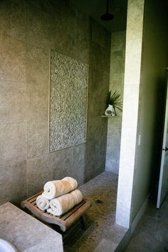 If you like the idea of having river rock beneath your feet in the bathroom but don't have the time, money or inclination for a full makeover, a river rock mat could be a perfect compromise. Set it outside the shower door or in front of the sink for a gentle foot massage every day.