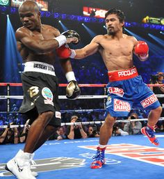 Manny Pacquiao throws a punch at Timothy Bradley during their WBO welterweight title match at the MGM Grand Arena in Las Vegas on Saturday. Bradley, who remains undefeated, ended Pacquiao's long. Manny Pacquiao, Pacquiao Vs, Sports Images, Sports Photos, Boxe Mma, Timothy Bradley, Boxing Images, Thai Box, Professional Boxing