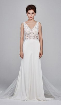 V-neck stretch satin slim gown with embroidery motifs and a tulle illusion skirt godet with embroidery detail.