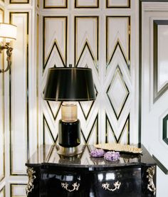 Black lacquer Table with Ornate Black, White, and Gold Detailed Wall