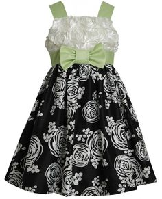 Beautiful little girl black/white/green printed shantung special occasion, flower girl, social party dress features: sleeveless bonaz bodice, square neckline, contrast shoulder straps and bow trim at waist, knee-length printed shantung skirt, back zipper and back ties Of polyester Machine wash Imported Matching/Coordinating sister sizes 4-16 available, search for style: BNJ-1688 Shipping and Returns Ships within 24-48 hours Returns accepted within 30-days of order date Item must be in new…