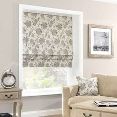 Crafted from a soft linen blend, this stone grey Roman blind features an intricate floral pattern and is lined to reduce external draughts. Available in a choice of sizes.
