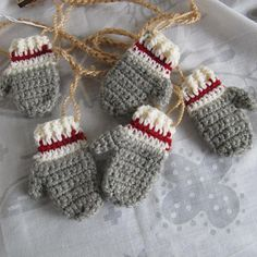 Work Sock style mini mitten garland / sock monkey mittens / striped mitten garland / Christmas garland Inspired by the iconic grey with cream and red striped traditional wool socks. Crochet Christmas Decorations, Crochet Ornaments, Christmas Crochet Patterns, Holiday Crochet, Crochet Snowflakes, Christmas Knitting, Crochet Home, Crochet Crafts, Yarn Crafts