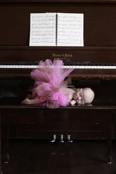 I WILL have a picture of my child like this -- baby girl in a tutu on the piano bench with open sheet music <3