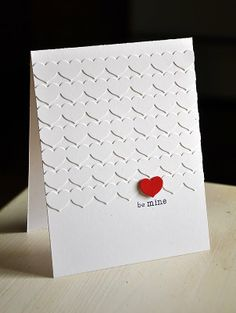 Like the idea of adapting this to make a wedding card ... a smaller area covered with white hearts with two red hearts included