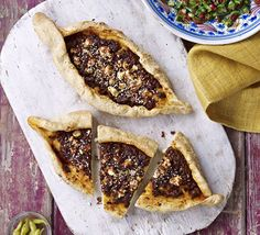 Sumac-spiced lamb pides. These boat-shaped Turkish pizzas are made with homemade dough and topped with spicy minced lamb and feta cheese