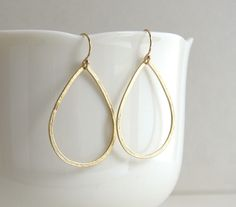 Delicate Hammered Gold Teardrop Hoops, Teardrop Earrings, Gold Teardrop Earrings, Gold Hoop Earrings - 14K Gold-Filled Ear Wires by sterlingandgrace on Etsy https://www.etsy.com/listing/200164407/delicate-hammered-gold-teardrop-hoops