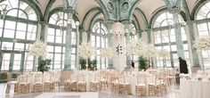 Pavilion at the Flagler Museum. Centerpieces in shades of white and ivory with an abundance of orchids, hyrangeas, and roses. #WeddingReceptions #FlaglerMusuem #FlowerCenterpieces