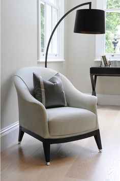 th2 Designs.© This upholstered chair provides the perfect place to relax, with an overhanging lamp for the late night readers.